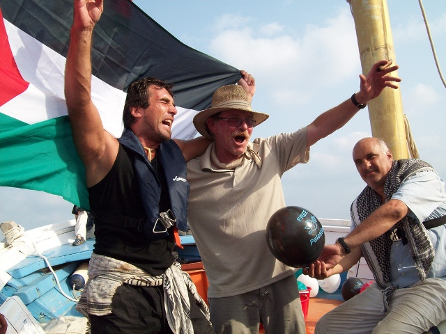 Vittorio Arrigoni, Captain John Klusmire, and Ren Tawil celebrate their arrival in Gaza (August 2008)
