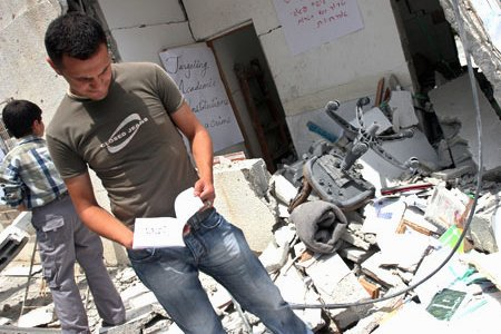 Students inspect the rubble of the Islamic University in Gaza. (MaanImages, Magnus Johansson), from freegaza.org